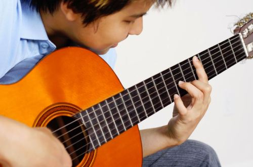 how to become a guitar teacher in schools
